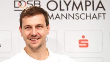 Timo Boll trägt die deutsche Fahne